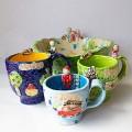 Vaisinė ir puodeliai šeimai